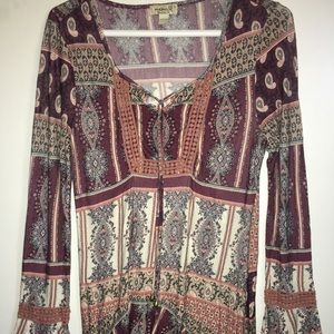 tunic with many designs and beaded front tie